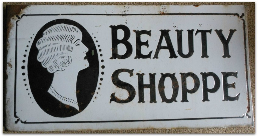 Curious goods trader art deco sign